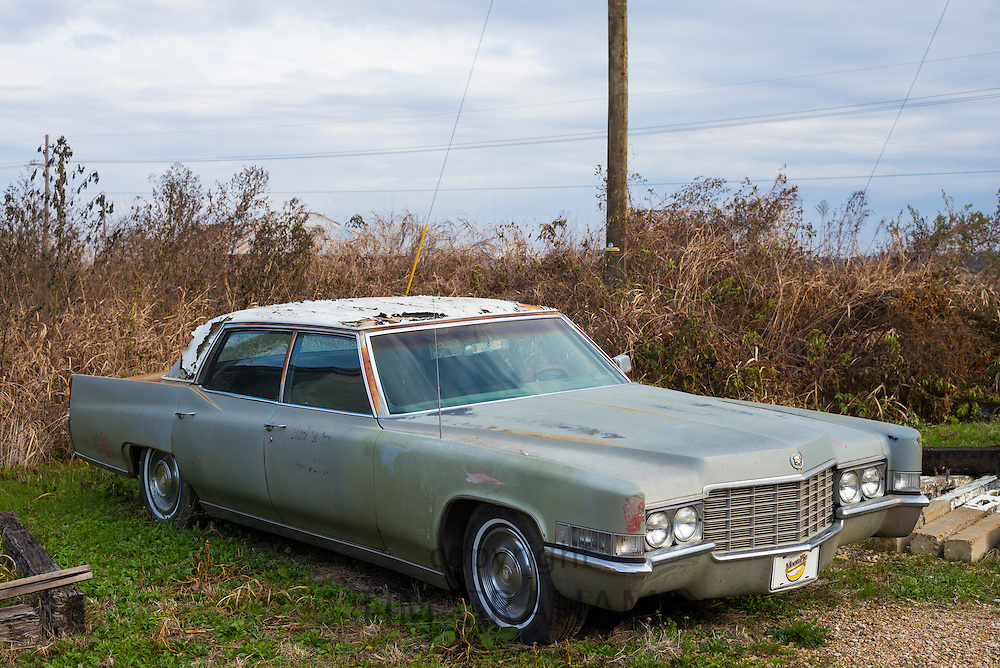 Abandoned gas guzzling rusty limo at The Shack Up Inn cotton sharecroppers theme hotel, Clarksdale, Mississippi, USA