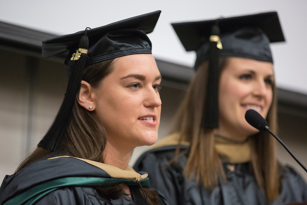 Class Presidents Elisabeth Rosenfeld, left, and Kelley Johnson, right, give the student commencement address at the Ohio University College of Business Commencement Ceremony on April 9, 2016. (Photo by Emily Matthews)