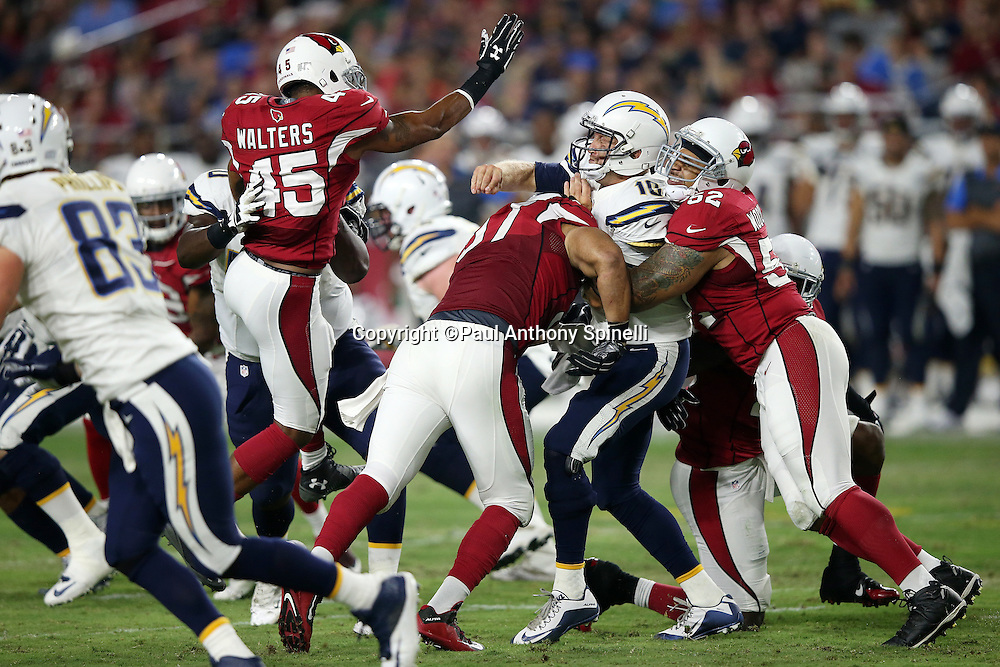San Diego Chargers quarterback Kellen Clemens (10) gets hurried on a backside hit by Arizona Cardinals linebacker LaMarr Woodley (52) and frontside pressure by Arizona Cardinals safety Anthony Walters (45) into throwing an incomplete pass and forcing a second quarter punt during the 2015 NFL preseason football game against the Arizona Cardinals on Saturday, Aug. 22, 2015 in Glendale, Ariz. The Chargers won the game 22-19. (©Paul Anthony Spinelli)
