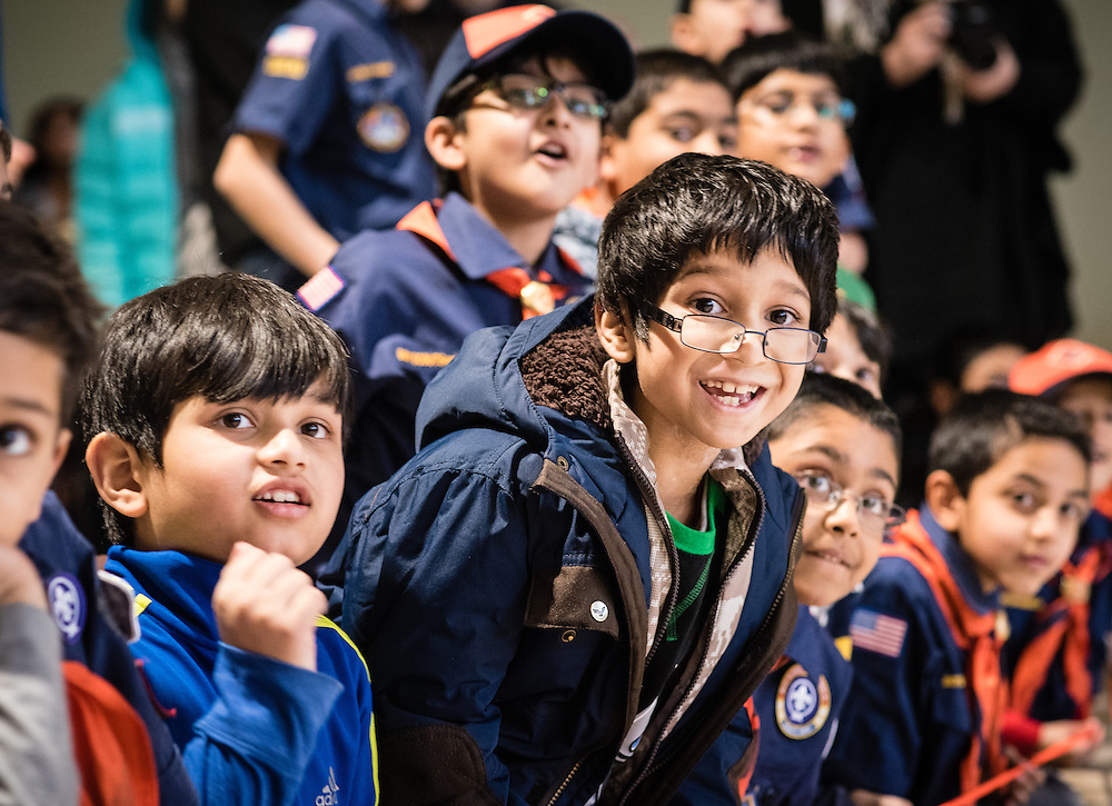 STERLING, VA -- FEBRUARY 13:  Jawadulla Mohammed, 8 (center with glasses), of Sterling, cheers as the cars go down the track. At left is Nubaid Shaik, 7, his neighbor and friend. Cub Scout Pack 1576 of the All Dulles Area Muslim Society, holds its Pinewood Derby. The mosque, which is one of the largest in the country, is home to one of the largest Boy Scout Troops in the region..…. (photo by Andre Chung for The Washington Post)