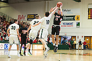 Rutland's Kyle Cassarino (12) shoots the ball over Rice's Elliot Nelson (20) and Jack Fitzgerald (10) during the boys high school semi final basketball game between the Rutland Raiders and the Rice Green Knights at Patrick Gym on Saturday afternoon February 27, 2016 in Burlington. (BRIAN JENKINS/for the FREE PRESS)