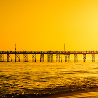 Panoramic photo of Newport Beach pier sunset in Orange County California. Balboa Pier is located on the Pacific Ocean on Balboa Peninsula in Newport Beach California. Panorama ratio is 1:3.
