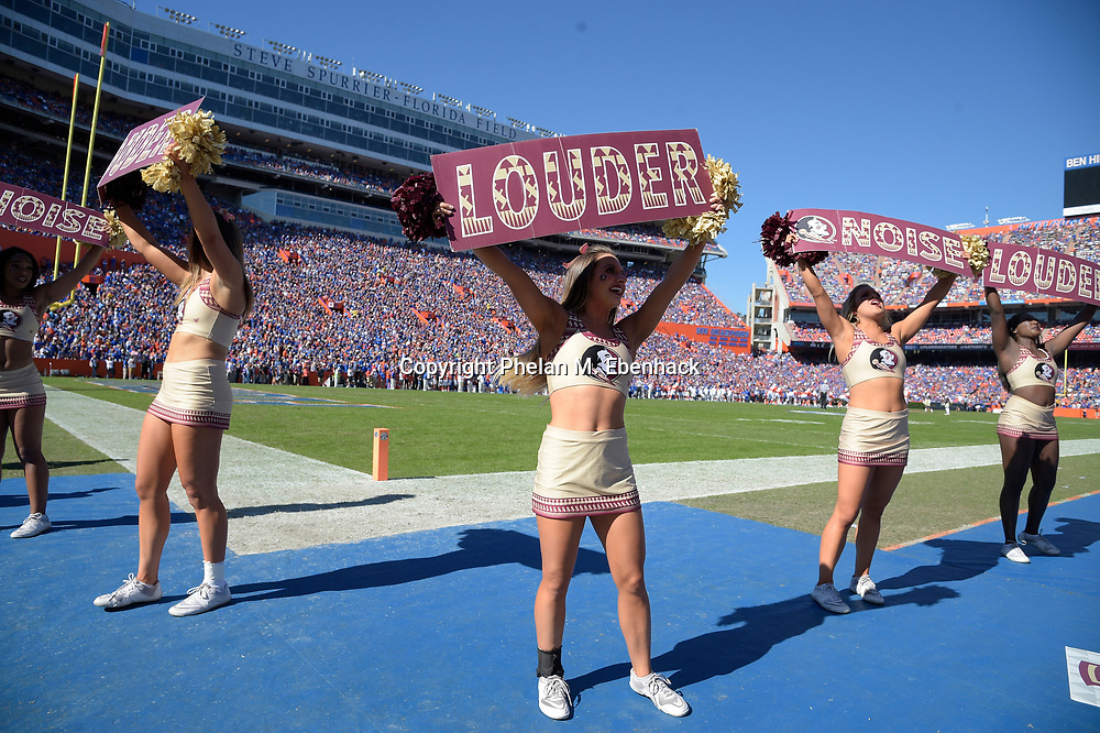 Florida State cheerleaders encourage the fans in the stands during the first half of an NCAA college football game against Florida Saturday, Nov. 25, 2017, in Gainesville, Fla. (Photo by Phelan M. Ebenhack)
