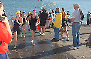 Deb Mosley finishes the swim portion of her triathalon at Lake Berryessa. Mosley's time was 2 hours 3 minutes for the half-mile swim, 15-mile bike and 4-mile run...Photo by Jason Doiy.10-9-04.027-2004.