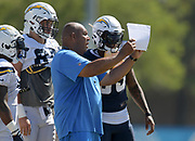 Aug 6, 2018; Costa Mesa, CA, USA: Los Angeles Chargers special teams coordinator George Stewart talks with safety Derwin James (33) during training camp at the Jack. R. Hammett Sports Complex.