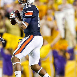 Sep 21, 2013; Baton Rouge, LA, USA; Auburn Tigers quarterback Nick Marshall (14) against the LSU Tigers during the second half of a game at Tiger Stadium. LSU defeated Auburn 35-21. Mandatory Credit: Derick E. Hingle-USA TODAY Sports