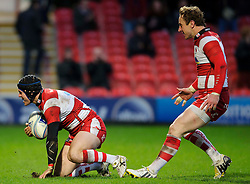 Gloucester Full Back (#15) Rob Cook scores a try early during the second half of the match as Scrum-Half (#9) Jimmy Cowan comes in to celebrate  - Photo mandatory by-line: Rogan Thomson/JMP - Tel: Mobile: 07966 386802 15/12/2012 - SPORT - RUGBY - Kingsholm Stadium - Gloucester. Gloucester Rugby v London Irish - Amlin Challenge Cup Round 4.