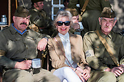 A visitor joins members of a home guard re-enactor group - Duxford Battle of Britain Air Show at the Imperial War Museum. Also commemorating the 50th anniversary of the 1969 Battle of Britain film. It runs on Saturday 21 & Sunday 22 September 2019