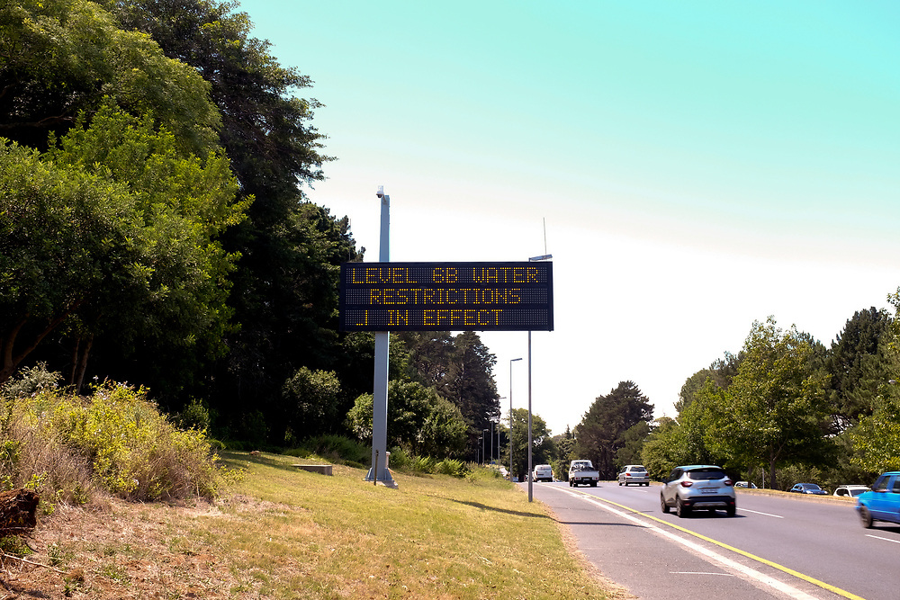 Sign on highway warns of level 6B water restrictions by the City of Cape Town. Penalties for using more than 50 litres per person per day are high. Cape Town.