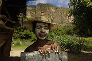 Local woman with sandalwood face mask - used as sun protection and a beautification. Sandstone Massif. Isalo National Park<br />