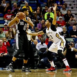 Mar 3, 2016; New Orleans, LA, USA; San Antonio Spurs center Tim Duncan (21) is defended by New Orleans Pelicans forward Anthony Davis (23) during the first quarter of a game at the Smoothie King Center. Mandatory Credit: Derick E. Hingle-USA TODAY Sports