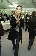 Du Juan. Backstage before the Chanel couture fashion show. Grand Palais, Ave Winston Churchill. Paris. 24  January  2006.  ONE TIME USE ONLY - DO NOT ARCHIVE  © Copyright Photograph by Dafydd Jones 66 Stockwell Park Rd. London SW9 0DA Tel 020 7733 0108 www.dafjones.com