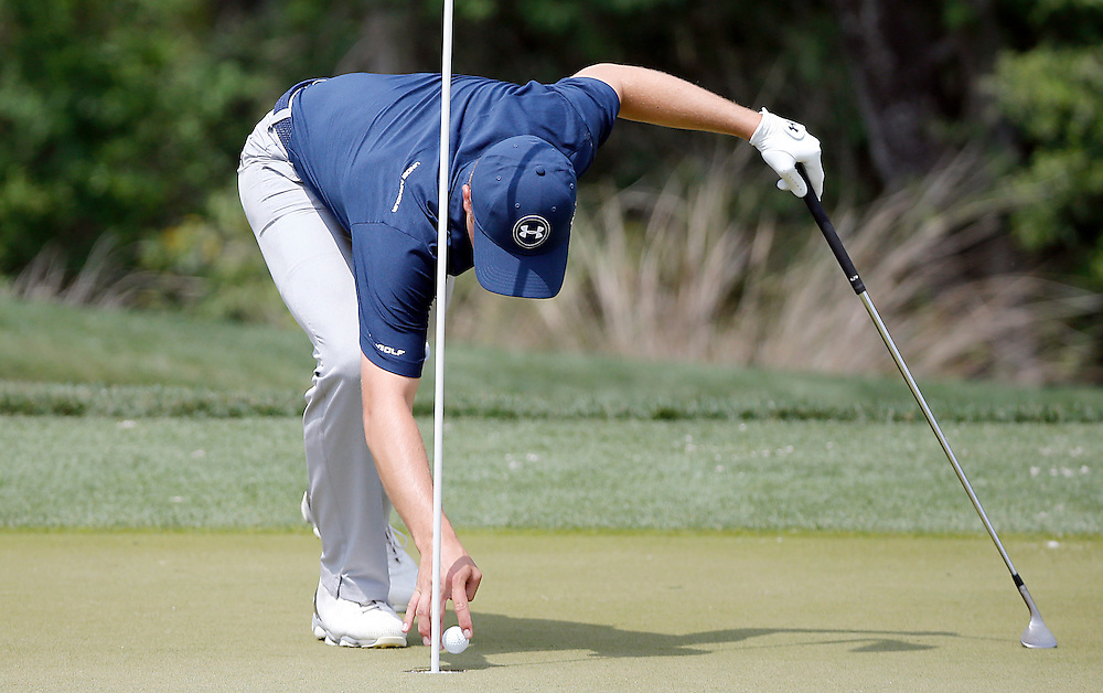 Jordan Spieth pulls his ball from the hole after birdied the second hole in the Shell Houston Open-Round 1 at the Golf Club of Houston on Wednesday, March 31, 2016 in Humble, TX. (Photo: Thomas B. Shea/For the Chronicle)