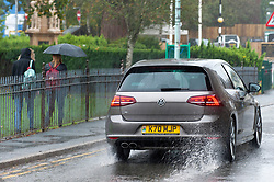 © Licensed to London News Pictures. 11/10/2019. Builth Wells, Powys, Wales, UK. Vehicles drive through surface water as heavy rain hits the small Welsh market town of Builth Wells in Powys, UK. Photo credit: Graham M. Lawrence/LNP