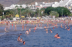 Puerto Rico; Gran Canaria; Canary Islands  beach scene with people swimming in sea,