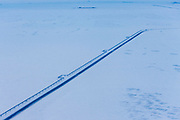 Oil pipeline and iceroad leading from the ConocoPhillips oilwells in Alpine, connecting to the Pump station 1 on the Alyeska Pipeline in Prudhoe Bay, the northern start of the Trans-Alaska Pipeline System.