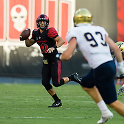 02 September 2017: San Diego State Aztecs quarterback Christian Chapman #10 rolls out of the pocket during the first quarter against the UC Davis Aggies. The Aztecs lead the Aggies 24-3 at the half at Qualcomm Stadium in San Diego, California. <br /> www.sdsuaztecphotos.com