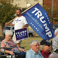 Adam Robison   BUY AT PHOTOS.DJOURNAL.COM<br /> Bryant Hargroue, of Amory, carries his Trump flag as he walks through Fairpark before the start of the Trump rally hosted by the Lee County Republicans Thursday night in Tupelo.