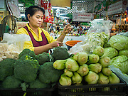 09 DECEMBER 2014 - THONBURI, BANGKOK, THAILAND: A vegetable vendor in her market stall in a market in the Thonburi section of Bangkok.     PHOTO BY JACK KURTZ