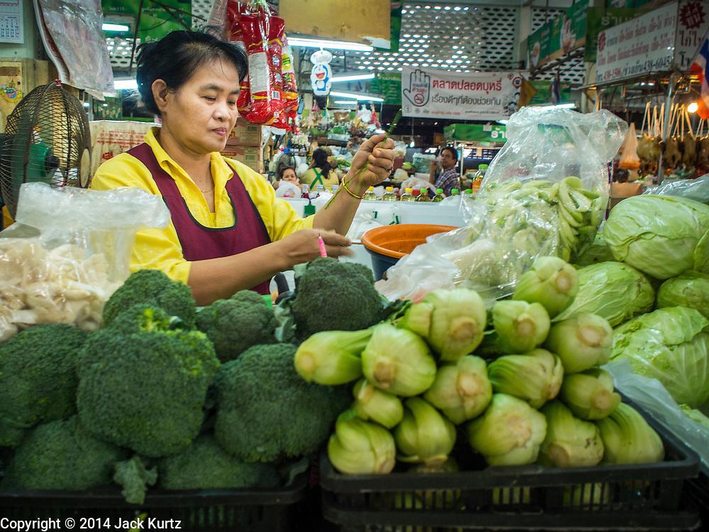 09 DECEMBER 2014 - THONBURI, BANGKOK, THAILAND: A vegetable vendor in her market stall in a market in the Thonburi section of Bangkok.     PHOTO BY JACK KURTZ