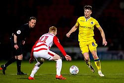 Ollie Clarke of Bristol Rovers takes on Ali Crawford of Doncaster Rovers - Mandatory by-line: Robbie Stephenson/JMP - 26/03/2019 - FOOTBALL - Keepmoat Stadium - Doncaster, England - Doncaster Rovers v Bristol Rovers - Sky Bet League One