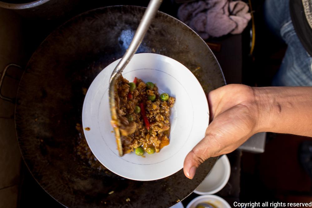 Dishing up prahok kati at Chanreash 10 Makara Restaurant