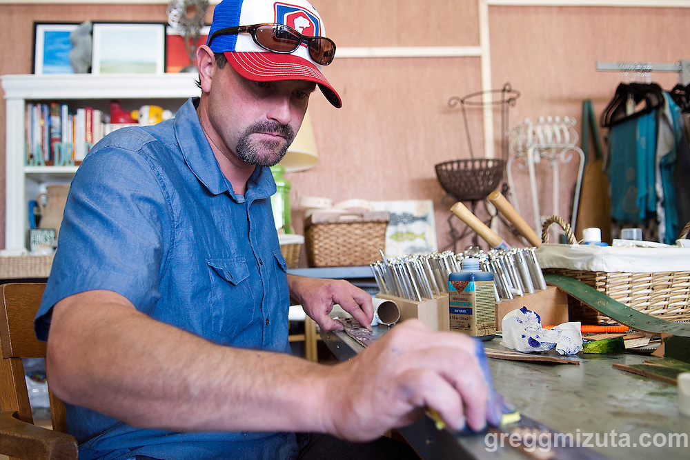 Matt Herberg applies dye on custom designed leather belts. Jodi Eichelberger's ST(r)EAM Artist Studio/Gallery bike tour in the Surel Mitchell Live-Work-Create District in Garden City, Idaho on June 18, 2016.<br /> <br /> Tour started at the studios of Susan Madacsi, April VanDeGrift, Erin Cunningham, and continued to Ken McCall Studios, James &amp; Matt Wilson of Red Valley Mandolins, Arin Arthur, Angie Bowling Sebolt, Belinda Isley, Matt Herberg, Lisa Roggenbuck and the Visual Arts Collective.