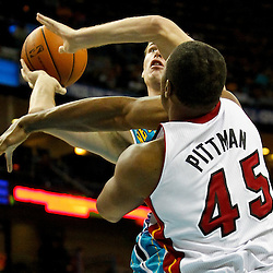 October 13, 2010; New Orleans, LA, USA; New Orleans Hornets power forward Jason Smith (14) shoots over Miami Heat center Dexter Pittman (45)during the second quarter of a preseason game at the New Orleans Arena. Mandatory Credit: Derick E. Hingle