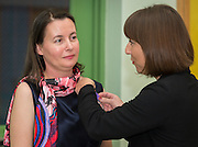 Claire Frazier, left, is awarded the Chevalier dans Ordre des Palmes Academiques by France Cultural Attache Sylvie Christophe, right, at Kolter Elementary School, November 20, 2013.