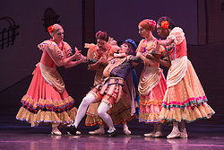 © Licensed to London News Pictures. 18/09/2015. London, UK. Boris Nowitsky (Carlos Renedo) as Count at the centre. Les Ballets Trockadero de Monte Carlo (The Trocks) perform the UK premiere of Don Quixote during a photocall at the Peacock Theatre. With Yakaterina Verbosovich (Chase Johnsey) as Kitri, PVyacheslav Legupski (Paolo Cervellera) as Basil, Olga Supphozova (Robert Carter) as Amour, Lariska Dumbcheno (Raffaele Morra) as Mother, Boris Nowitsky (Carlos Renedo) as Count and Varvara Bractchikova (Giovanni Goffredo) and Eugenia Repelskii (Joshua Thake) as Gypsies. Photo credit: Bettina Strenske/LNP