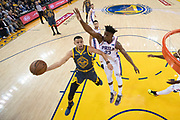 January 31, 2019; Oakland, CA, USA; Golden State Warriors guard Stephen Curry (30) shoots the basketball against Philadelphia 76ers guard Jimmy Butler (23) during the first half at Oracle Arena.