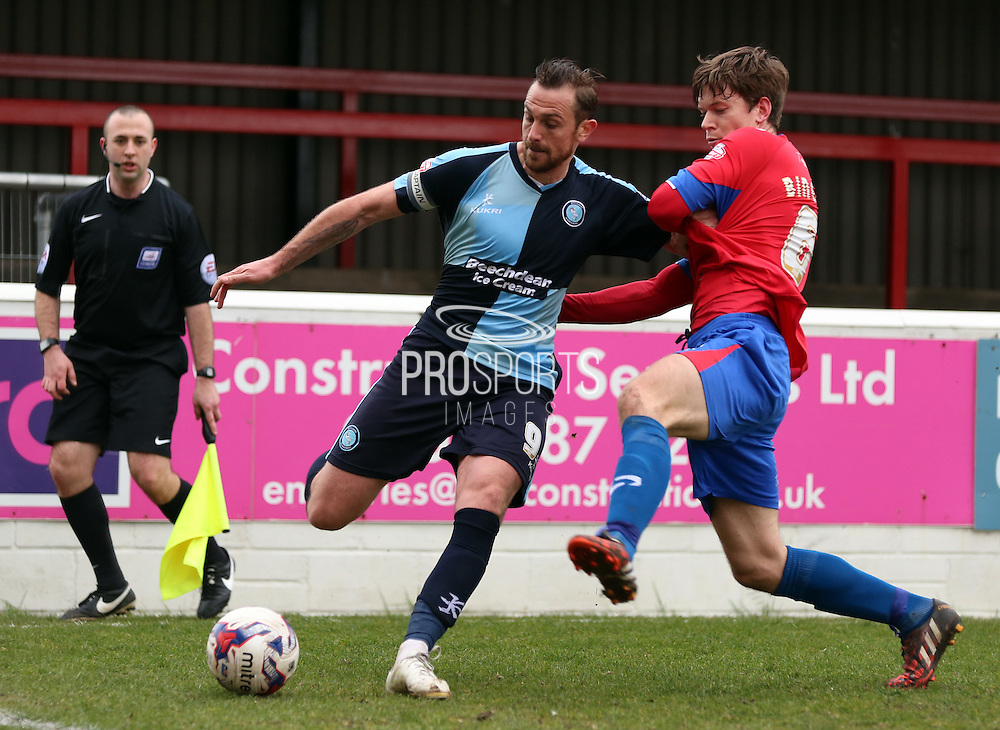 Paul Hayes  crossing ball during the Sky Bet League 2 match between Dagenham and Redbridge and Wycombe Wanderers at the London Borough of Barking and Dagenham Stadium, London, England on 28 March 2015. Photo by Matthew Redman.