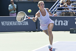 August 21, 2018 - New Haven, CT, USA - Camila Giorgi of Italy returns a shot against Belinda Bencic of Switzerland during their second-round match at the Connecticut Open Tennis Tournament in New Haven, Conn., on Tuesday, Aug. 21, 2018. Bencic advanced, 6-4, 6-4. (Credit Image: © John Woike/TNS via ZUMA Wire)