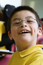 Child with Cerebral Palsy  in a lesson,