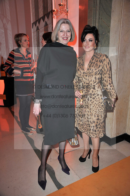Left to right, The Home Secretary THERESA MAY MP and NANCY DELL'OLIO at the 38th Veuve Clicquot Business Woman Award held at Claridge's, Brook Street, London W1 on 28th March 2011.
