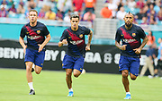 FC Barcelona midfielders Arthur (8) Coutinho (7) and Arturo Vidal (22) warm up before the game with SSC Napoli during a La Liga-Serie A Cup soccer match, Wednesday, Aug. 7, 2019, in Miami Gardens, Fla. FC Barcelona beat Napoli 2-1 (Kim Hukari/Image of Sport)