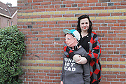 Woman knitted life-size replica of her teenage son because he didn't want to cuddle her any more <br /> <br /> A Dutch woman has knitted a life-sized replica of her teenage son as he no longer wants to hug and and instead spends time hanging out with his friends. <br /> Marieke Voorsluijs from Amsterdam is well known in The Netherlands for making unusual creations out of wool. <br /> So when her young son said he no longer wanted to hug her all the time, she decided to put her skills to use and create a replica. <br /> <br /> Ms Voorsluijs said: 'My son is reaching puberty. We used to cuddle all the time, but those days are becoming scarce. Now he rather hangs with friends, plays with his phone and listens to his ipod. Exactly according to nature's plan. I am a good mother, so of course I accept this and I am happy he is a healthy kid.<br /> 'We laugh a lot about the stretching gap between his needs and mine. Him needing more of his own space and my covert needs to keep on smothering him with maternal love. I am a textiles designer and he often helps me and has great creative ideas. So we started to fantasize how we could visualize this puberty gap. So I suggested to make a cuddly version of him!<br /> <br /> <br /> We are always making and creating stuff and I love to knit unknittable things. My husband is a designer too, so my son is very familiar with the process. My two sons love the project and helped with the making of the cap and, of course, posing. They always help with the projects I make for my work and private. And we help them back of course with their creative ideas.<br /> Ms Voorsluijs can create almost any idea using her knitting skills and has made cuddly bottles of champagne. <br /> Other designs feature oysters, cheese boards and even a giant joint of ham. <br /> Ms Voorsluijs, who has two sons, said they were both fine with her creation, which took approximately two months to complete.  <br /> ©clubgeluk/Exclusivepix Media