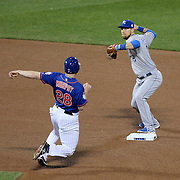Ben Zobrist, Kansas City Royals, turns a double play as Daniel Murphy, New York Mets, slides in to second base during the New York Mets Vs Kansas City Royals, Game 5 of the MLB World Series at Citi Field, Queens, New York. USA. 1st November 2015. Photo Tim Clayton
