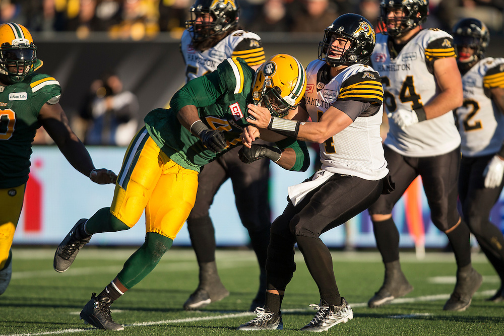 Hamilton quarterback Jeremiah Masoli is hit after by Edmonton's Odell Willis during the 4th quarter of the CFL's Eastern Semi-Final against the Hamilton Ticats   in Hamilton on Sunday November 13, 2016.  (CFL PHOTO - Geoff Robins )