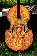 An upright bass, hand decorated by Michele Iacovitti Peraino, on display at Appel Farm's 2017 Music & Wine Festival.