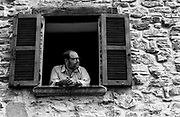 Writer Umberto Eco at a window of his holiday home in Montecerignone, August 1989.