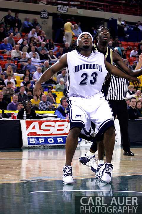 26 November 2005: MU junior Marques Alston (23) blocks out ORU's Caleb Green in the Monmouth University 54-62 loss to Oral Roberts University at the Great Alaska Shootout in Anchorage, Alaska