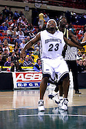 26 November 2005: MU junior Marques Alston (23) blocks out ORU's Caleb Green in the Monmouth University 54-62 loss to Oral Roberts University at the Great Alaska Shootout in Anchorage, Alaska