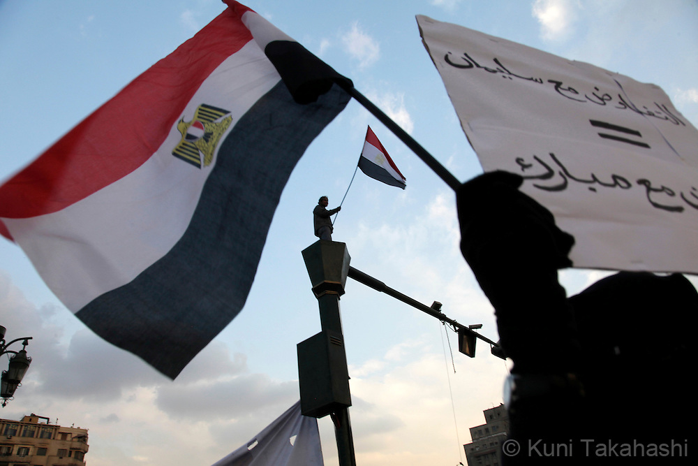 Anti-government protesters hold Egyptian flags as they demand president Hosni Mubarak to step down in Tahrir Square in Cairo, Egypt on Feb 7, 2010. .Photo by Kuni Takahashi