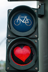 Red heart painted on stop light for bicycles in Berlin Germany