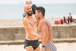 © Licensed to London News Pictures.01/07/2017. Brighton, UK. Brighton and Hove Albion Football team's Captain BRUNO SALTOR GRAU, also known as BRUNO and sports model FELIPE LIRA play a game of football on the beach in Brighton and Hove with some friends. Photo credit: Hugo Michiels/LNP
