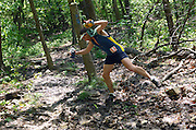David Garman, from Jefferson, MD, keeps his balance on a muddy course during the  Massanutten Mountain Trails 100 Mile run (MMT 100) May 17, 2008..Garman completed the run with a time of 30:16:21.  ..The  race is considered one of the toughest Ultra Marathons on the east coast. The  Massanutten Mountain Trails 100 Mile run (MMT 100) May 17, 2008.<br /> The  race is considered one of the toughest Ultra Marathons on the east coast.