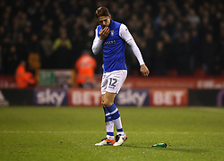 Glenn Loovens of Sheffield Wednesday looks at a bottle thrown at him by a Sheffield United fan - Mandatory by-line: Robbie Stephenson/JMP - 12/01/2018 - FOOTBALL - Bramall Lane - Sheffield, England - Sheffield United v Sheffield Wednesday - Sky Bet Championship