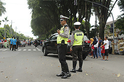 April 29, 2019 - Madiun, East Java, Indonesia - Police personnel secure urban lanes with open systems following the cultural ceremony of welcoming the newly appointed head of the Madiun City area (Credit Image: © Ajun Ally/Pacific Press via ZUMA Wire)