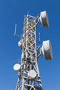 microwave parabolic dish antenna radio link on lattice tower on Mount Inkerman, Queensland, Australia